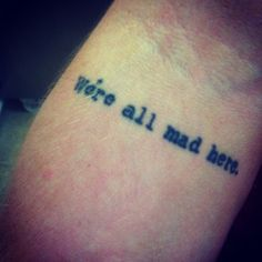 We're all mad here tattoo. Chesire cat, Alice in Wonderland. On the back of my neck, and under it in white ink the Cheshire Cat smile