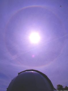 A full solar halo -- plus a dragonfly -- seen above John Chumack's observatory dome on September 15, 2013. Credit and copyright: John Chumack/Galactic Images.