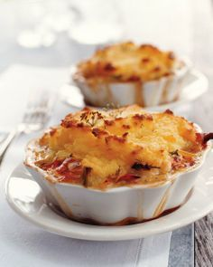 Transform shepherd's pie into an elegant dish fit for company by substituting lobster for the traditional ground beef or lamb. The individual mashed potato-topped pies can be baked in fluted ramekins, shallow ovenproof casseroles, or even Pyrex bowls. Fish Dishes, Seafood Dishes, Fish And Seafood, Seafood Pot Pie, Lobster Dishes, Lobster Recipes, Seafood Recipes, Red Lobster Deviled Crab Recipe, Shellfish Recipes