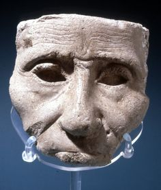 Sculptor's plaster-cast model of an aged face; cut off at the forehead and mouth. Amarna. British Museum