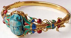 This Marcus & Co. multicolored enamel and gold Egyptian Revival bangle bracelet