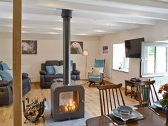 A cosy, converted, beamed stone cottage with an inviting wood-burning stove. Living Room Tv Cabinet, Ikea Living Room, Living Rooms, Interior Decorating, Interior Design, Interior Architecture, Decorating Ideas, Cosy Lounge, Coffee Table Design