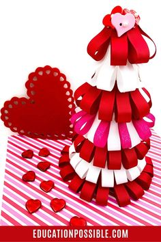 This fun and easy Valentine's Day ribbon loop tree craft takes about 30 minutes to create, so it's a great project for you and your older kids. After you make it together, you can use it to decorate for the holiday or give it away as a special gift for a friend. It's simple to customize them, so encourage your tweens and teens to make one for their room. Valentines For Kids, Valentine Day Crafts, Valentine's Day Crafts For Kids, Activities For Kids, February Holidays, Weird Holidays, Diy Ribbon, Tree Crafts, Tree Decorations