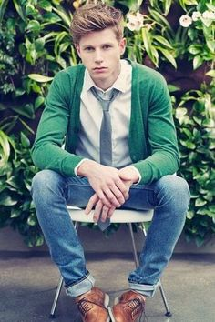 Men's Green Cardigan, White Polo, Blue Jeans, Tan Leather Brogues