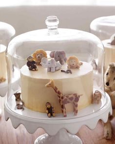 Adorable marzipan animals on this Brown-Sugar Layer Cake with Caramel Buttercream Frosting. Perfect for a child's birthday or baby shower!