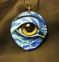 "One of my polymer clay eye pendants. This one is from ""Avatar!"""