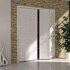 Kimberly Bay 36 in. Plantation Louvered Solid Core Painted White Wood Interior Bi-fold Closet Door-DPBPLLW36 at The Home Depot