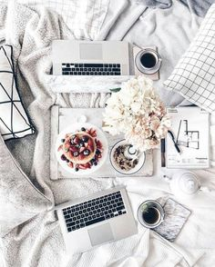 Laptops and breakfast in bed - flatlay