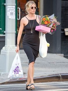 Sienna Miller paired a fabulous little black dress with crystal clear, retro round sunnies for chic street style!