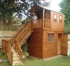 wooden playhouse with storage shed underneath project code pc050835 by the playhouse company