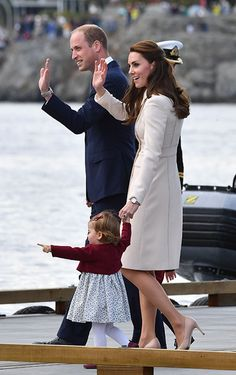 The Duke and Duchess of Cambridge waved to the crowds as their toddler pointed at the seaplane in excitement.