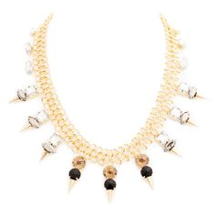 Get noticed in the bold and beautiful Ursula necklace. This sexy statement maker features smoky topaz, clear crystal, and onyx stones, and unmissable gold spikes, all strung from its unique infinity chain. This striking vision is all the glam you need.