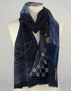 If casual elegance is your look, this is your scarf. Its medium weight vintage indigo-dyed fabric with Japanese sashiko accents. The base fabric is dark