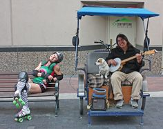 Treasure Valley Rollergirl and a busker - downtown.