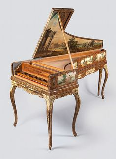 A single-manual harpsichord by Aelpidio Gregori, Sant Elpidio, '1797'and no '?', the case of false inner-outer construction, the exterior extensively painted circa 1900 with figures in landscapes, the figures on printed paper, the exterior of the lid similarly decorated, the interior of the lid painted with an extensive landscape with classical ruins, the wrestplank of walnut, the soundboard of cypress, the fasciaboard possibly of poplar with central geometrical inlays, the four octave…