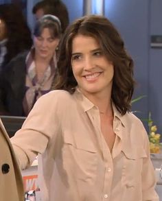 Robin's cream/beige shirt on How I Met Your Mother. Outfit details: http://wornontv.net/8617/