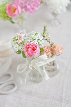 snip a few flowers from the garden and tie with ribbon - the most inexpensive and darling centerpiece