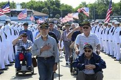 5/21/2013-Surviving crewmembers of the USS Franklin(CV 13) walk toward USS Yorktown(CV 10) for their final reunion May 17,2013, at Patriots Point Naval and Maritime Museum in Mt. Pleasant, S.C. On March 19, 1945, the Franklin was hit by two Japanese bombs, which ignited armed aircraft and triggered a gasoline vapor explosion devastating the hangar bay, killing more than 800 Sailors and wounding nearly 500. (U.S. Air Force photo/Staff Sgt. Anthony Hyatt)