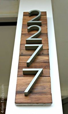 Love this idea for home address. Cute numbers with a wood background. May do…