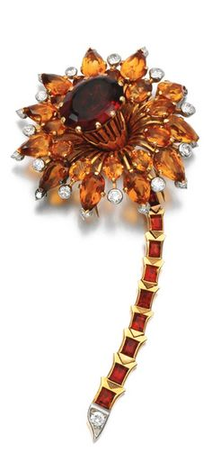 Citrine and diamond brooch, Cartier, circa 1940 The flower set with oval and pear-shaped citrines and circular-cut diamonds, the articulated stem set with calibré-cut citrines, signed Cartier.