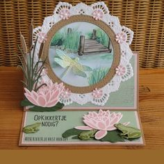 Handmade card by Jeanette Bron with Creatables Tiny's Frogs and Dragonfly (LR0461), Tiny's Water Lily (L) (LR0460), Petra's Circle with Bird (LR0457), Tiny's Cattails (LR0409) and Craftables Basic Passepartout Circles (CR1360) from Marianne Design