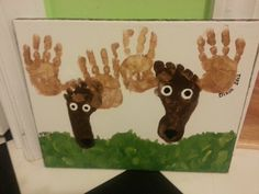 Hand print art, feet art makes a deer