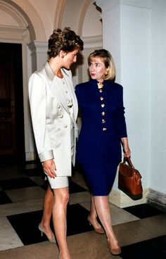 A moment captured with Hillary Clinton during a luncheon at the British Embassy—each of them clad in a gold buttoned skirt suit.   - MarieClaire.com