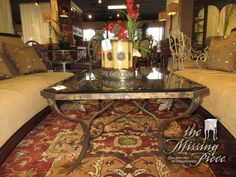 "Glass top coffee table on a bronze metal base with ornate curved legs. Love the scroll details visible just below the glass. Great size for placing in front of larger sofa. 46""long x 33""deep x 20""high."