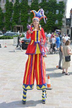 Medieval jesters both on stilts or off.