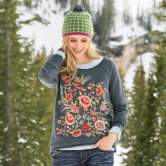 """EDEN SWEATSHIRT--Comfort gets exotic in this hi-lo embroidered cotton sweatshirt with rolled, raw edges, as birds of paradise fly over vibrant blooms. Cotton. Machine wash. Imported. Sizes XS (2), S (4 to 6), M (8 to 10), L (12 to 14), XL (16). Front approx. 27""""L."""