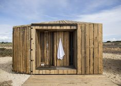 Lisbon studio Aires Mateus used only reclaimed timber to construct this pair of waterfront cabins in Grândola, Portugal