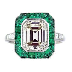 Emerald and Emerald Cut Diamond Platinum Engagement Ring | From a unique collection of vintage engagement rings at http://www.1stdibs.com/jewelry/rings/engagement-rings/