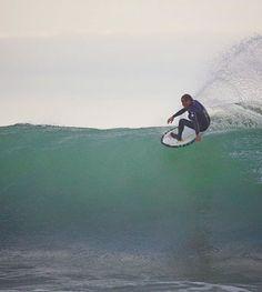 Tom Curren on a skimboard