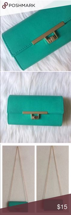 "Teal multiway bag Twist lock clutch/ crossbody/ wristlet. Measures 8"" long, 4"" tall, and 2"" wide. Crossbody strap has a 20"" drop. Chain can be tucked inside or removed. The inside has two compartments separated by a zippered section. Gold hardware. Comes with a strap to make it a wristlet. This has a faux leather look and feel. Color is a mint teal.  ⭐️This item is brand new with tags 💲Price is firm unless bundled ✅Bundle offers Bags Crossbody Bags"