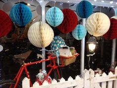 Our Christmas window at Daisy Park 2013. Use various sizes of honeycomb paper lanterns