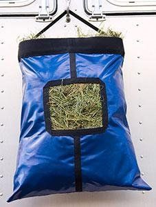 "EasyCare Stowaway Deluxe Hay Feeder - Navy by Easyboot. $46.75. Color: Navy. Feed your horse in style with this easy-to-use hay bag! Made with durable and waterproof vinyl, this hay tote will hold up to two large flakes of hay. The top rim is rigid for easier access and filling. The heavy-duty, detachable nylon hanging strap makes for easy hanging on just about anything. Dimensions: 27""L x 19""W x 6""D.. Save 15%!"