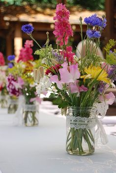 Summer garden flower jam jars made with locally grown flowers. Natural wedding f… Summer garden flower jam jars made with locally grown flowers. Natural wedding flowers, green weddings, eco wedding flowers by Wild & Wondrous www. Natural Wedding Flowers, Country Wedding Flowers, Wedding Table Flowers, Wedding Table Decorations, Decoration Table, Flower Decorations, Wedding Bouquets, Sweet Pea Wedding Flowers, Cornflower Wedding Bouquet