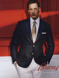 Like this one - the golden tie makes the look go just so many notches .. white pants and jacket.. interesting for sure
