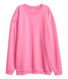 Pink. Oversized sweatshirt with dropped shoulders, wide sleeves, and ribbing at neckline, cuffs, and hem. Soft, brushed inside.