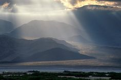 Crepuscular rays over alluvial fan (read: cool sunbeams over hills) in Death Valley National Park, CA. [OC][680x1024] : EarthPorn