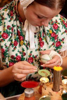 A woman creating an encaustic Sorbian Easter egg.