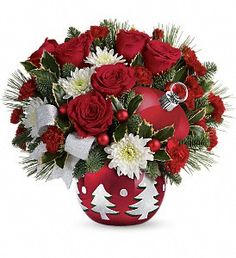 A beautiful ornament fill with all you favorite Christmas flowers