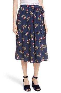 fd3f9193f83 Soft gathers at the waist billow the midi-length cut of a silken wrap skirt