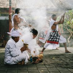 Untitled. Kris dancers and permangku - priest - in a temple ceremony performance in Bali. Photo by Dave Giunta