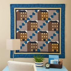 Row Houses wall quilt pattern. Build this wall hanging row by row, pairing house blocks and bow tie blocks. Pattern only 2.99      Approx. size: