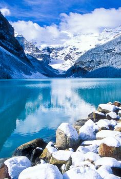 September snow covers the rocks along the shore of Lake Louise. Banff National Park, Alberta, Canada.  Photo: Jerry Mercier via Flickr