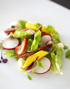 Strawberries, mango, pecans and radishes on top of a bed of butter lettuce is the perfect summer salad served at #Viceroy #Maldives #summersalad #IslandDestinations
