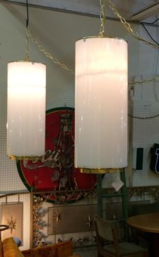 Pair of White Cylinder And Brass Swag Lamps   $250  Booth 766  Lula B's 1010 N. Riverfront Blvd. Dallas, TX 75027  Open: Mon. to Sat. 10A to...