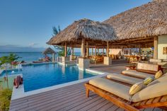 Little Harvest Caye offers stunning views from the private pool, deck, and open-air palapa.