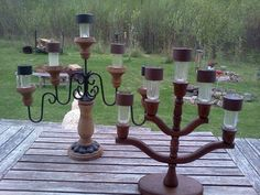 Candelabras from the Thrift Shop, $2 each and solar lights from the Dollar Tree. Lighting up my patio at night for $7 each!